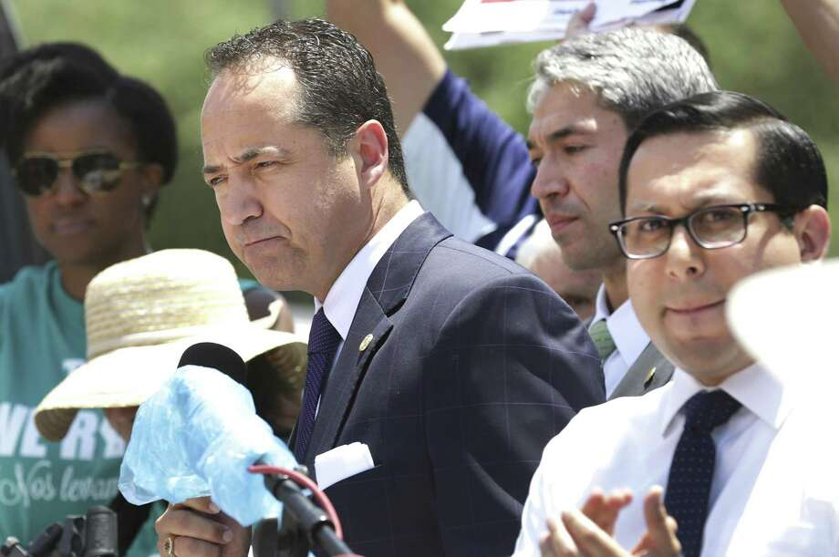 Texas State Senator Jose Menendez, left, speaks at a rally against SB 4 with San Antonio Mayor Ron Nirenberg, center, and Texas State Representative Diego Bernal, right,  in front of the Federal Courthouse in San Antonio, Tx, on Monday, June 26, 2017. Photo: Bob Owen, Staff / San Antonio Express-News / ©2017 San Antonio Express-News
