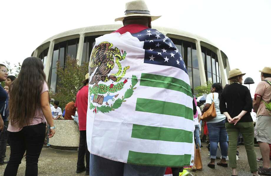 A so-called sanctuary cities bill signed by Texas Gov. Greg Abbott could kill up to 248,000 jobs and shrink the state's economy by up to $13.8 billion when the law takes effect, according to an analysis by the group Reform Immigration for Texas Alliance. Photo: Bob Owen /San Antonio Express-News / ©2017 San Antonio Express-News