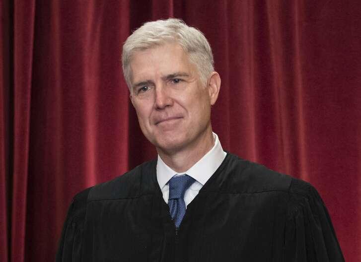 FILE - In this June 1, 2017, file photo Supreme Court Associate Justice Neil Gorsuch is seen during an official group portrait at the Supreme Court Building Washington. For those wondering where Gorsuch will fit on the Supreme Court's ideological spectrum, the best early clue might be to watch the company he keeps. Gorsuch has already paired up four times with Justice Clarence Thomas _ the court's most conservative member _ in separate opinions that dissent from or take issue with the court's majority rulings. (AP Photo/J. Scott Applewhite, File)