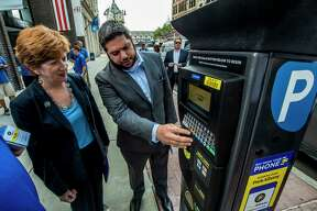 Albany Parking Authority's executive director Matthew Peter  unveils their new parking meters and mobile app to Mayor Kathy Sheehan Monday June 26, 2017 at Albany, N.Y.  (Skip Dickstein/Times Union)