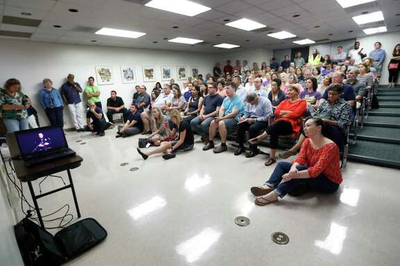 An overflow crowd packs an adjacent room to listen to a town hall meeting with Mayor Sylvester Turner and Police Chief Art Acevedo on Monday at the Rubenstein Jewish Community Center.
