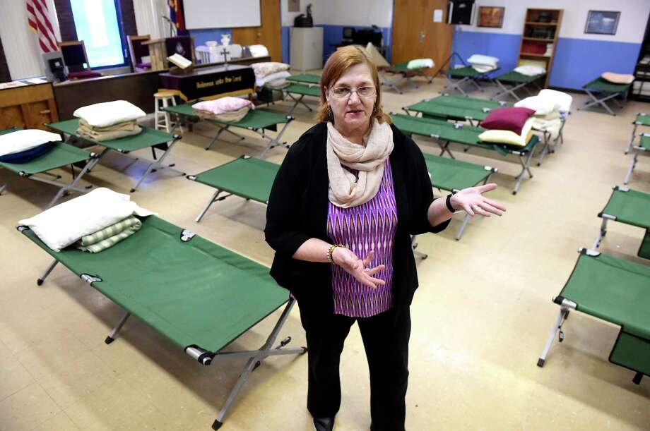 Cheryl Ann Murphy-Parant, director of Code Blue Saratoga, among the cots used for homeless people on Wednesday, Jan. 27, 2016, at The Salvation Army in Saratoga Springs, N.Y. Murphy-Parant said the operation is a bridge between the shelters, that require clients to be sober, and the outside. (Cindy Schultz / Times Union) Photo: Cindy Schultz / Albany Times Union