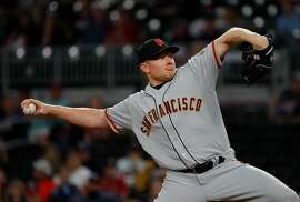 ATLANTA, GA - JUNE 20:  Mark Melancon #41 of the San Francisco Giants pitches in the ninth inning against the Atlanta Braves at SunTrust Park on June 20, 2017 in Atlanta, Georgia.  (Photo by Kevin C. Cox/Getty Images)