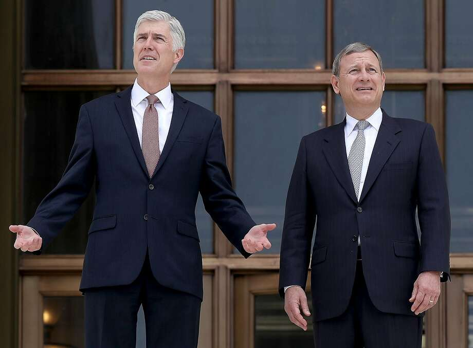 WASHINGTON, DC - JUNE 15:  Supreme Court Justice Neil Gorsuch (L) talks with Chief Justice John Roberts (R) on the steps of the Supreme Court following his official investiture at the Supreme Court June 15, 2017 in Washington, DC. Gorsuch has been an active member of the court since his confirmation though the official investiture ceremony was held today.  (Photo by Win McNamee/Getty Images) Photo: Win McNamee, Getty Images
