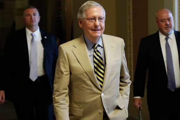 """Senate Majority Leader Mitch McConnell of Ky. walks from his office on Capitol Hill in Washington, Monday, June 26, 2017. Senate Republicans unveil a revised health care bill in hopes of securing support from wavering GOP lawmakers, including one who calls the drive to whip his party's bill through the Senate this week """"a little offensive."""" (AP Photo/Carolyn Kaster) ORG XMIT: DCCK103"""