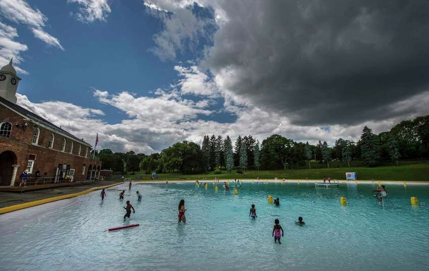 Even with an imposing cloud above kids enjoy a dip in the Lincoln Park Pool Monday June 26, 2017 at Albany, N.Y. (Skip Dickstein/Times Union)