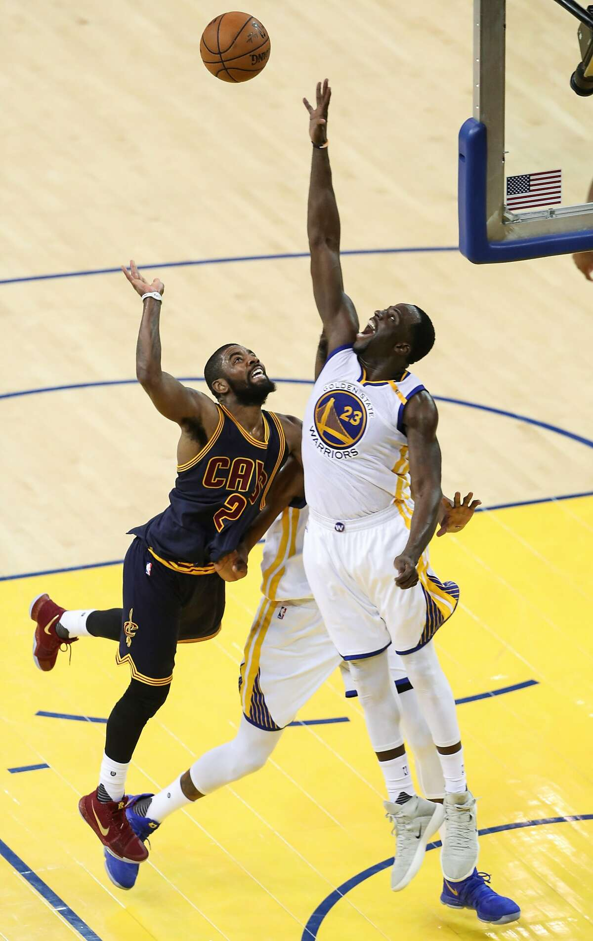 Golden State Warriors' Draymond Green defends against Cleveland Cavaliers' Kyrie Irving in the third quarter during Game 1 of the 2017 NBA Finals at Oracle Arena on Thursday, June 1, 2017 in Oakland, Calif.