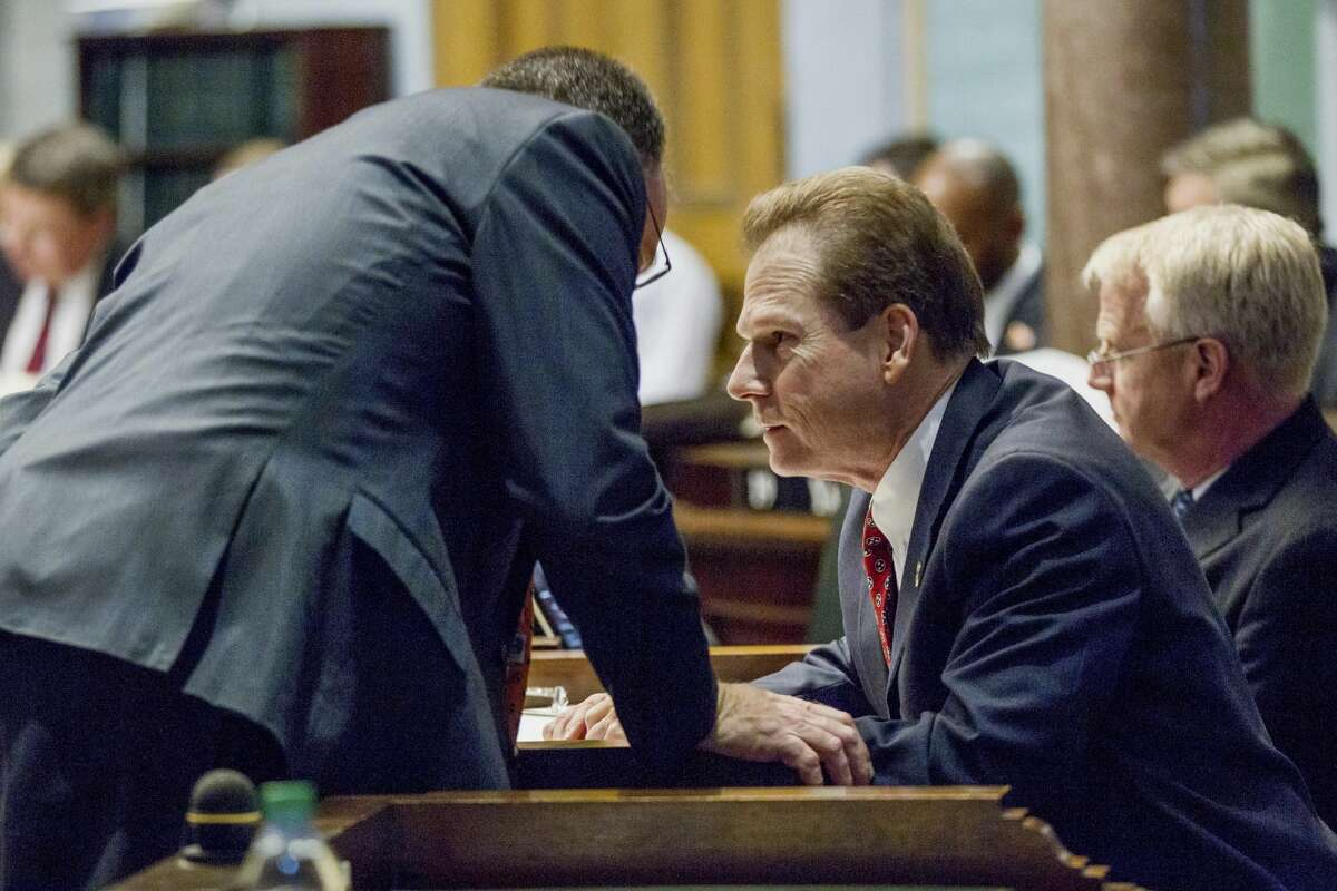 Sen. Joey Hensley, R-Hohenwald, right, confers with Sen. Mike Bell, R-Riceville, on the Senate floor in Nashville, Tenn., Monday, March 27, 2017.