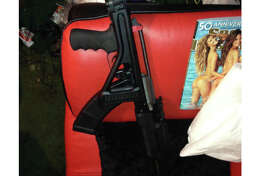 An AK-47-style rifle is pictured at the home of a man to whom Seattle resident Michael Riley is alleged to have sold heroin. Riley, 54, was caught with large quantities of heroin and meth, as well as a stolen AK-47-style rifle.