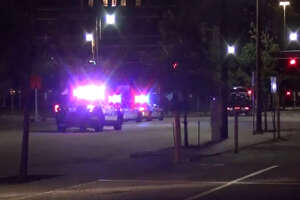 Houston police investigate after an officer and prisoner were slightly injured in a downtown crash with a taxi about 10 p.m. Monday, June 26, 2017. (Metro Video)