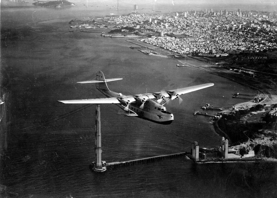 1935: One of the first passenger airplanes flies over the unfinished Golden Gate Bridge in San Francisco. The China Clipper was a pioneer for air travel in the U.S. Photo: Clyde Sunderland