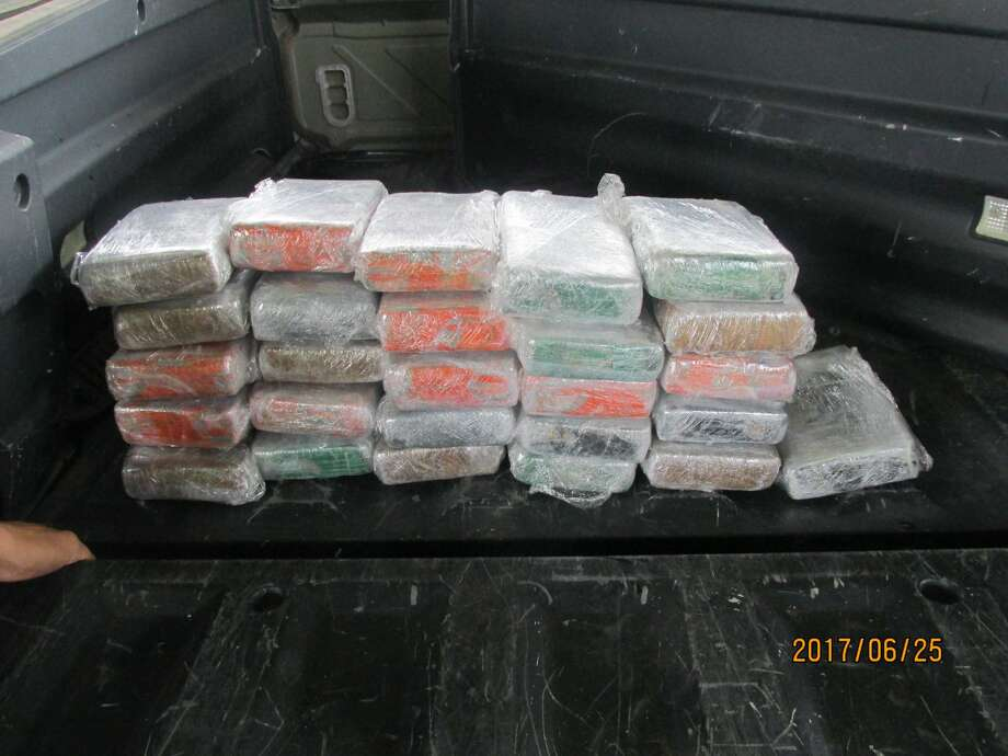 The bundles contained over 65 pounds of cocaine with an estimated value of $2.1 million. Photo: CBP