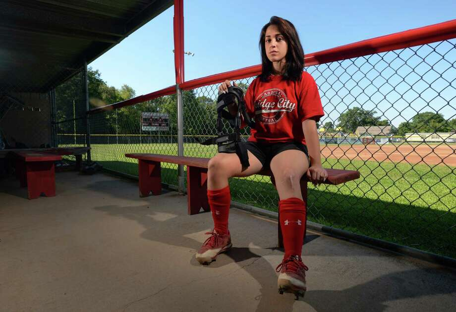 After tearing her ACL and breaking her tibia, Maggie Garcia underwent surgery and now has to wear a knee brace while playing softball.  Photo taken Thursday, June 08, 017 Guiseppe Barranco/The Enterprise Photo: Guiseppe Barranco, Photo Editor