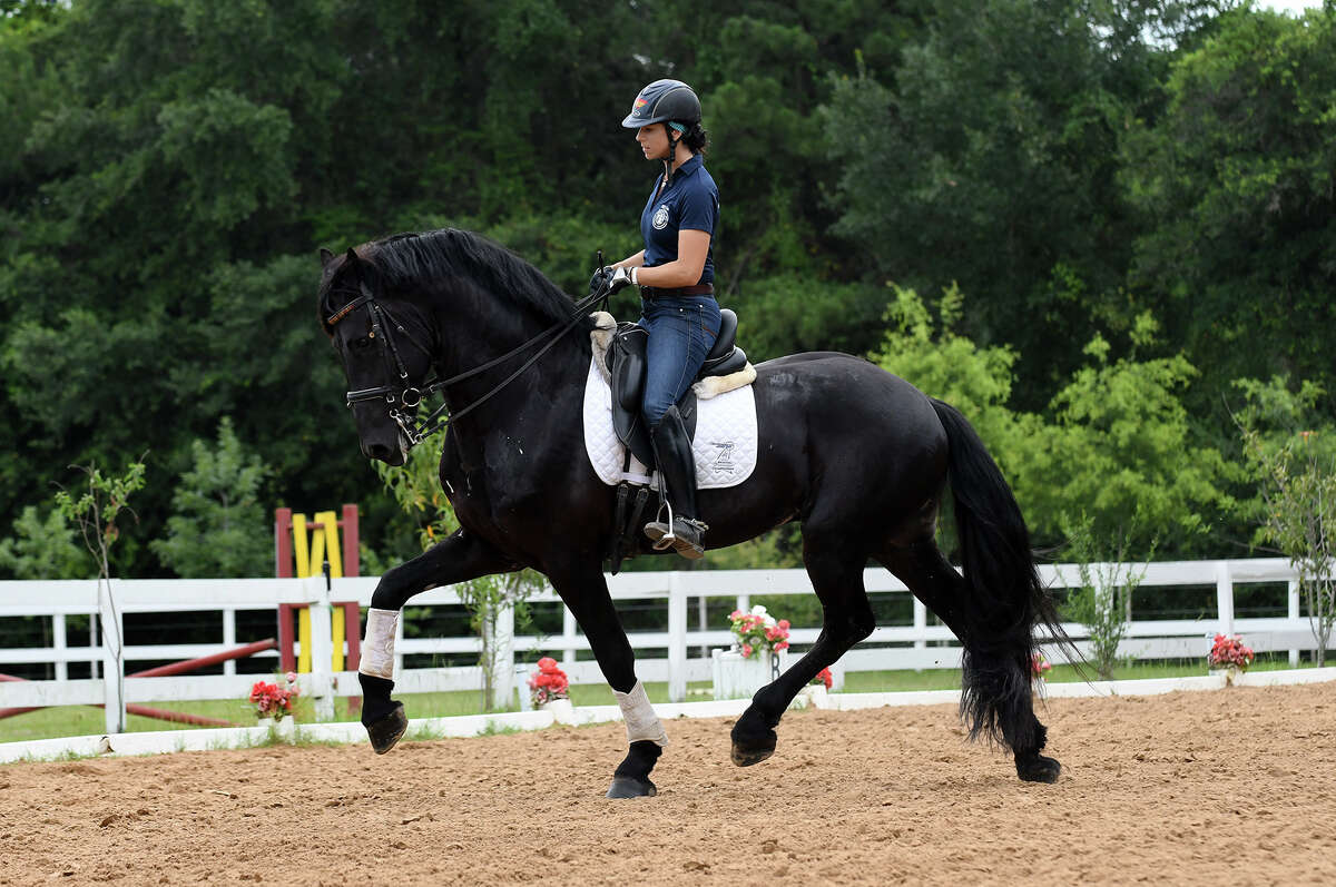 Marta Renilla, General Manager & Head Dressage Trainer of Woodlands Equestrian Club, rides