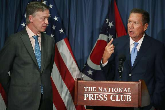 WASHINGTON, DC - JUNE 27: Gov. John Kasich (R-OH) (R) and Gov. John Hickenlooper (D-CO) participate in a bipartisan news conference to discuss the Senate health care reform bill at the National Press Club on June 27, 2017 in Washington, DC. The governors called on Senate Democrats and Republicans to work together to come up with a better health care bill. (Photo by Mark Wilson/Getty Images)
