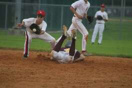 Deer Park's Jayden Miller uses a head-first slide to barely beat a throw down to second base. He would be the first of many to reach second base and beyond during a six-run third inning Monday night that all but sewed up a trip to Tuesday night's championship game at Bay Area Park.