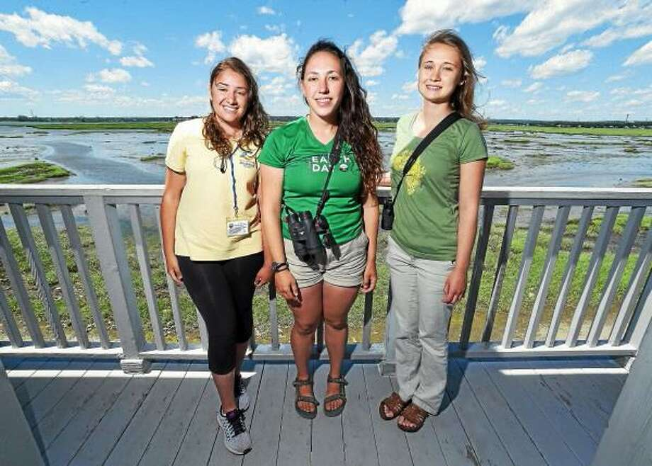 Left to right, Melina Giantomidis, IBA Coastal Ranger, Helena Ives, field technician for the Audubon Alliance for Coastal Water Birds, and Genevieve Nuttall, Osprey Nation Coordinator, are photographed at The Connecticut Audubon Society Coastal Center at Milford Point in Milford. Photo: Hearst Connecticut Media / Arnold Gold