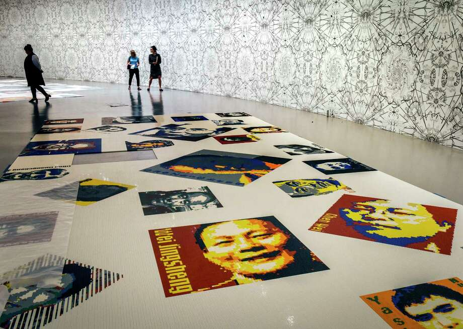 """In """"Trace,"""" Lego bricks create pixelated images of 157 men and 19 women from 30 countries, including Nelson Mandela, Martin Luther King Jr., Rwandan journalist Agnes Uwimana Nkusi and Chinese dissident and winner of the Nobel Peace Prize Liu Xiaobo. Photo: Washington Post Photo By Bill O'Leary / The Washington Post"""