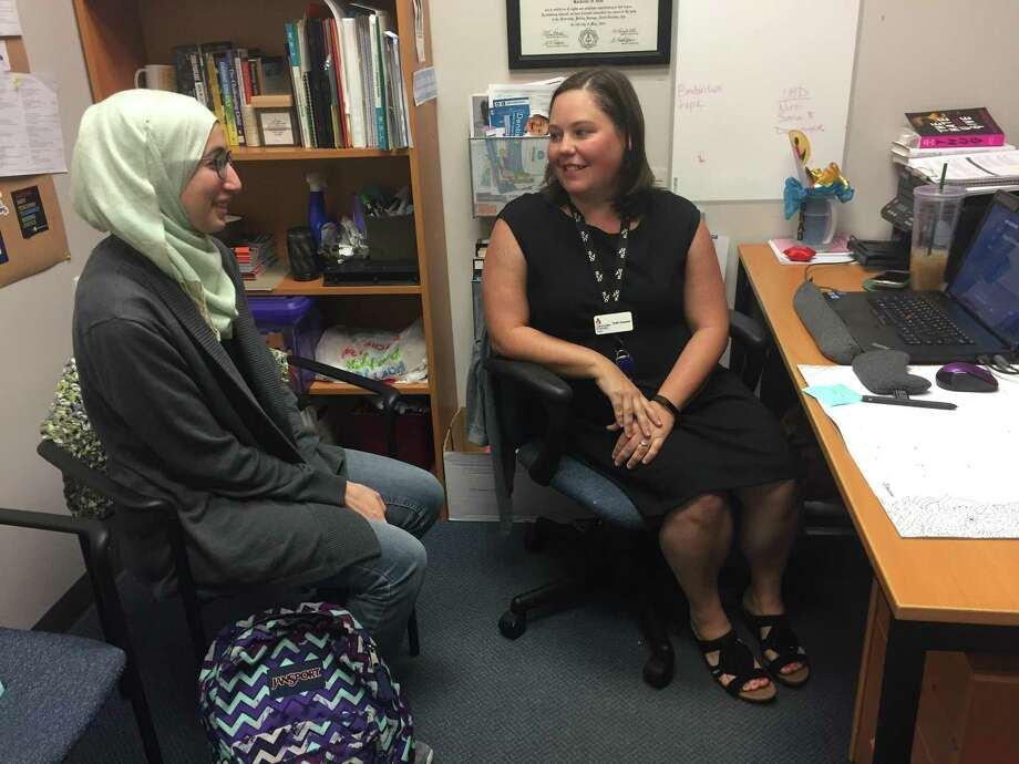 Kristin Carpenter, CIS Project Manager for the Bridge Program, speaks to student Salma Almasri about her coursework. The Bridge Program at HCC's Spring Branch Campus provides an easy transition in the summer for starting college in the fall. Photo: Rebecca Hazen