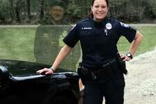 """Cleveland ISD Police Officer Pamela Minchew says the """"ghost"""" image in her Facebook photo is actually a tribute to her late grandfather, who was a law enforcement officer like her."""