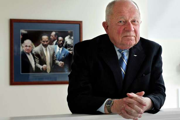 FILE - In this May 22, 2014 file photo, famed defense attorney F. Lee Bailey poses in his office in Yarmouth, Maine. Bailey has filed for bankruptcy again to tie up loose ends following his bankruptcy filing in 2016. His bankruptcy attorney said Tuesday, June 27, 2017, the new filing aims to resolve liens on his Maine home, personal property, pensions and book royalties, and to set up a payment plan.