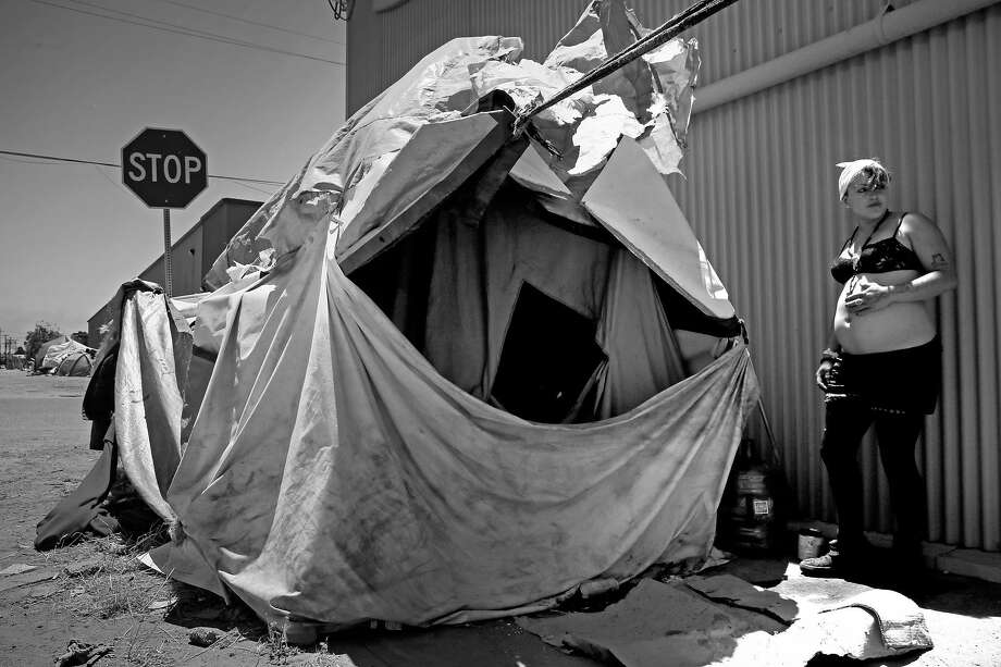 Samatha, 22 who is 8 months pregnant and been homeless for 5 years is living in an encampment on the corner of Cedar and 2nd streets in Berkeley. Photo: Michael Macor, The Chronicle
