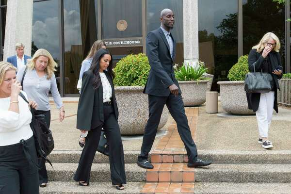 Former NBA star Kevin Garnett, second from right, leaves the federal courthouse in San Antonio Tuesday, June 27, 2017 after attending a hearing in Tim Duncan's legal case against Duncan's former financial adviser Charles Banks. Duncan alleges he lost more than $20 million to Banks in a series of investments from 2005 to 2013.