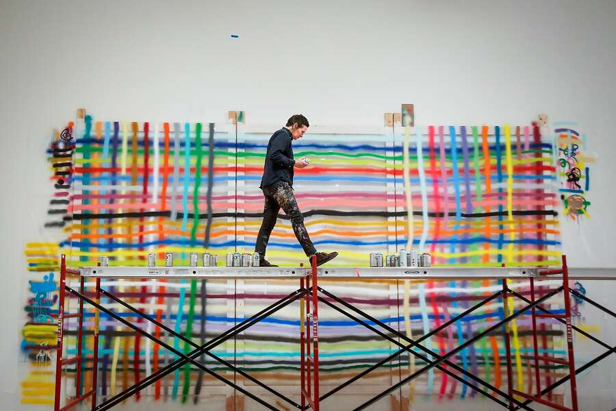 Alicia McCarthy works on her exhibit, a large piece on plexiglas, in the San Francisco Museum of Modern Art in San Francisco on Friday, June 23, 2017. Photo: Nicole Boliaux, The Chronicle