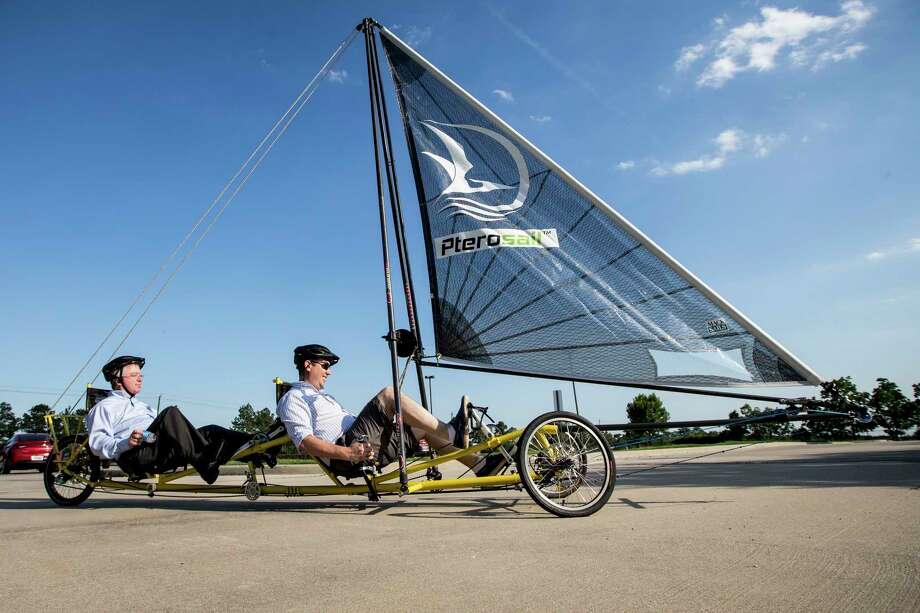 John MacTaggart, right, gives a ride on a Pterosail Twin to Thomas Davis during a demonstration of Pterosail Systems on Thursday, June 8, 2017, in Houston. ( Brett Coomer / Houston Chronicle ) Photo: Brett Coomer, Staff / © 2017 Houston Chronicle