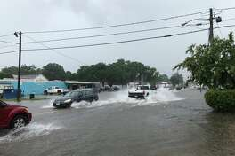Very heavy rain flooding College Street in Beaumont on Tuesday, June 27, 2017.