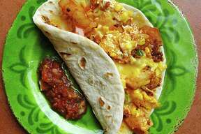 Taco of the Week: Chorizo Delight taco with chorizo, potatoes, cheese, scrambled eggs and pico de gallo on a handmade flour tortilla from Taco Riendo.