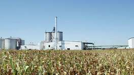 The Mid Missouri Energy ethanol plant rises out of the cornfields near Malta Bend, Mo. The plant takes about 20 percent of the 90 million bushels of corn grown in the area to produce ethanol. Legislation to lift a longtime summer ban on gasoline with a higher concentrations of ethanol was introduced by a bipartisan coalition of Midwestern lawmakers.