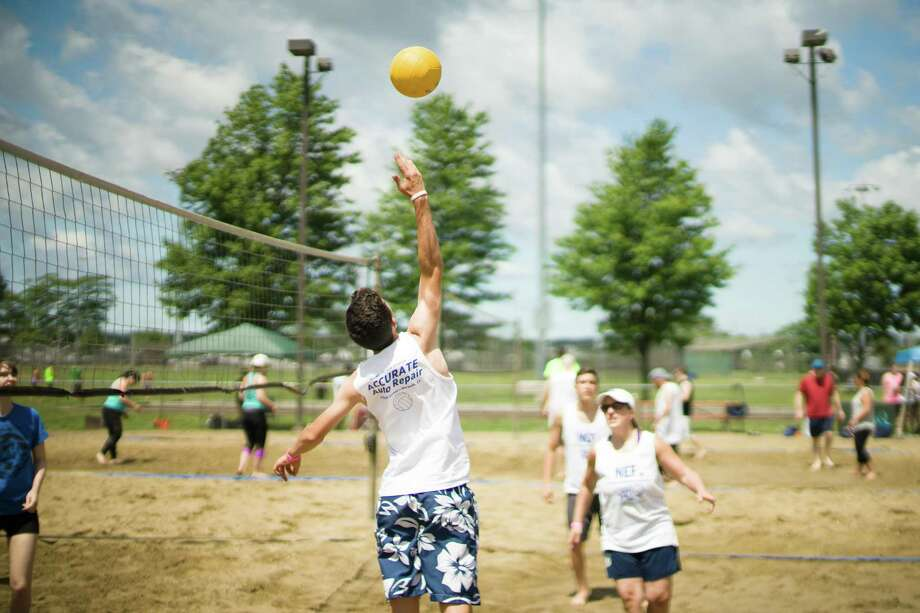 Roughly 100 community members and dozens of volunteers helped raise more than $5,000 this past weekend at the Second Annual Accurate Auto Volleyball Tournament held at Calf Pasture Beach in Norwalk, Conn. on Saturday, June 24, 2017. Photo: Taylor Scicchitano / Contributed Photo / Norwalk Hour contributed