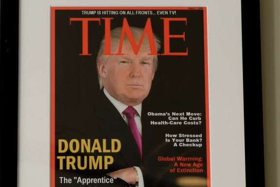DORAL, FLORIDA, JUNE 24, 2017 Framed portrait of President Donald Trump on the cover of a TIME Magazine and other magazine covers framed and hanging from a wall at the Trump National Doral Miami Golf Shop. (Photo by Angel Valentin for the Washington Post)