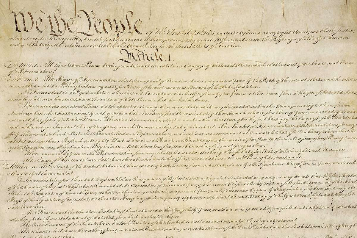 This photo from the U.S. National Archives shows a portion of the first page of the United States Constitution.