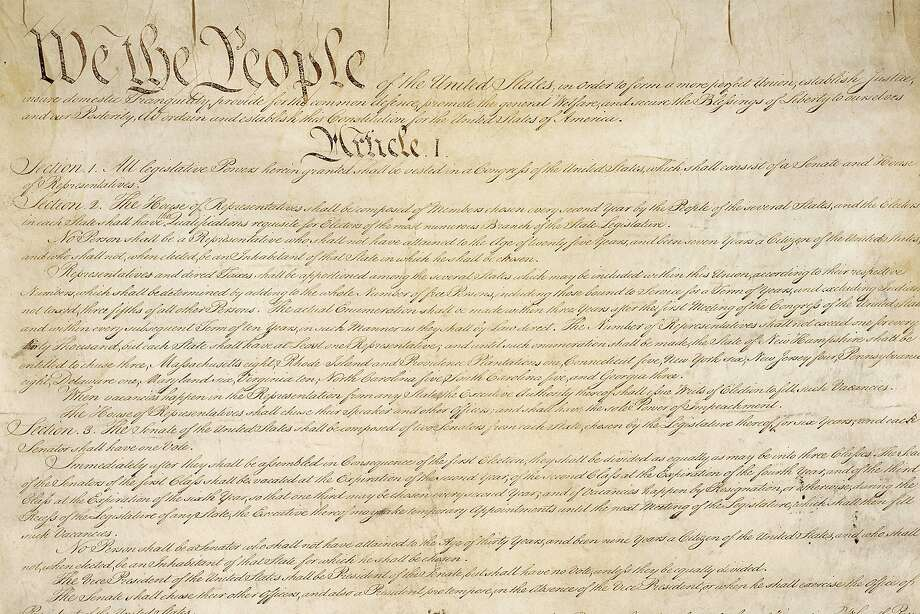 This photo from the U.S. National Archives shows a portion of the first page of the United States Constitution. Photo: Associated Press