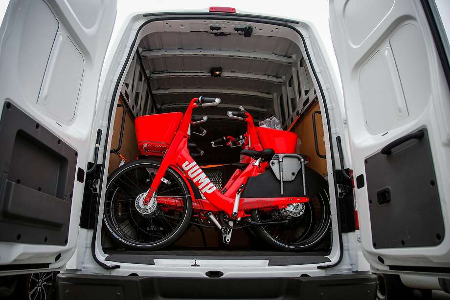 A Jump bike from Social Bicycles, an e-bike sharing pilot in San Francisco, sits in a van to be unloaded. Photo: Nicole Boliaux, The Chronicle