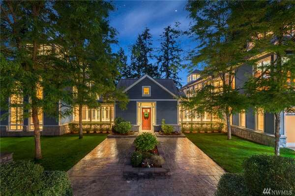 A gated and private residence perfectly appointed on 1.15 acres. Turreted architecture and sky-high windows welcome occupants to a light-filled oasis, with a full-equipped chef's kitchen, outdoor putting green, theater, and 2,000 bottle wine cellar. Escape to a master wing with executive den, or enjoy the waterfront from the 120-foot high-bank waterfront.   7634 N.E. 170th St., listed for $2,100,000. See  the full listing here .