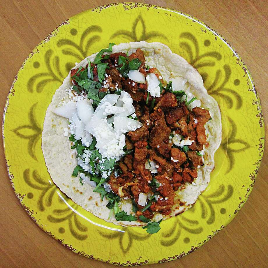Callejero taco with al pastor, chorizo, onions, cilantro and cotija cheese on a handmade corn tortilla from El Matehuala Cafe. Photo: Mike Sutter /San Antonio Express-News
