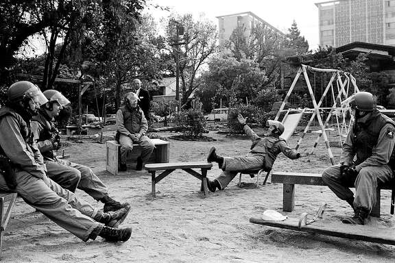 May 15, 1969 - Berkeley, California, USA: Alameda County Sheriff's sit on benches in People's Park after clearing it early one morning.� Students took over University land and made a park. Police cleared the park, a riot ensued. Police fired into the crowd killing a few people.