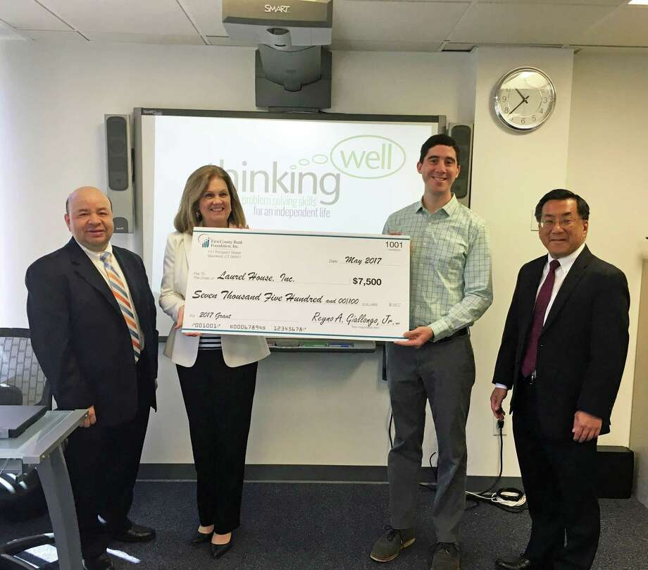Camilo Duque, Jr., Assistant Vice President-Branch Manager (pictured right) and Michael Yao, Vice President-Senior Commercial Banking Officer (pictured left) presented Linda Autore, President and CEO of Laurel House Inc. and Gregg Pauletti, Thinking Well and Supported Education Manager, with a $7,500 grant from the First County Bank Foundation for their Thinking Well program. Laurel House, based in Stamford, is a nonprofit  serving eight towns in lower Fairfield County from Westport to Greenwich and provides resources and opportunities for people living with mental illness. Photo: Contributed