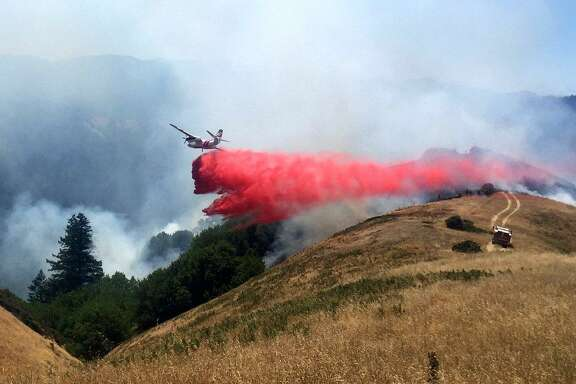 A Calfire tanker dropped flame retardant on a fire Tuesday.