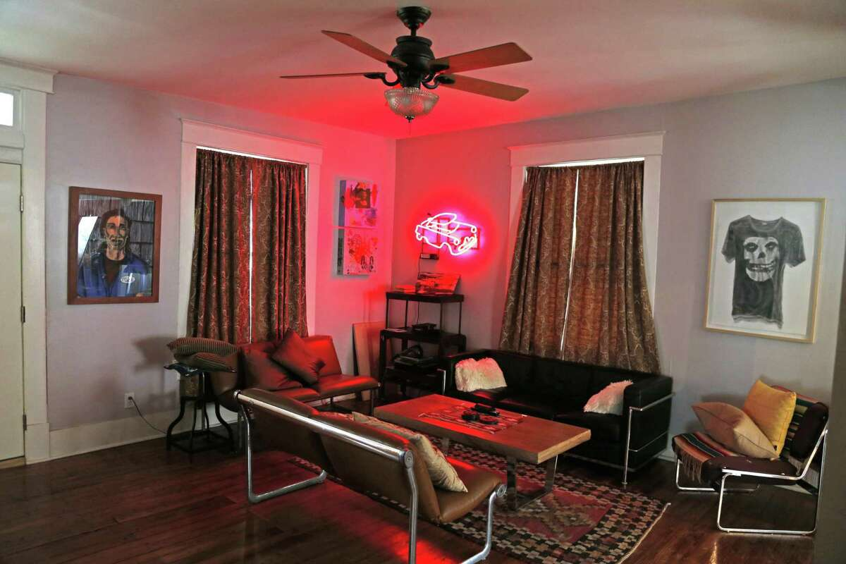Richard Armendáriz's living room is sparsely furnished and features artwork by Katie Pell and Ken Little.