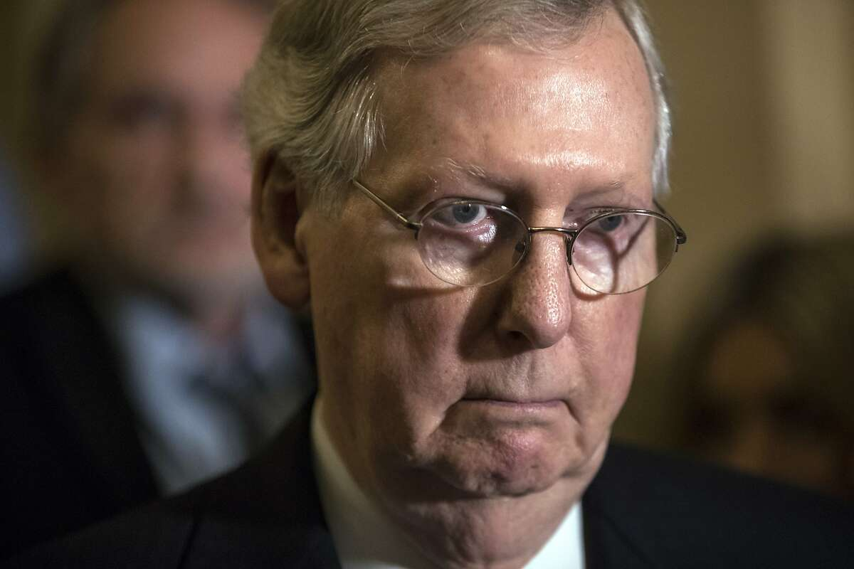 Senate Majority Leader Mitch McConnell, R-Ky., tells reporters he is delaying a vote on the Republican health care bill while GOP leadership works toward getting enough votes, at the Capitol in Washington, Tuesday, June 27, 2017. (AP Photo/J. Scott Applewhite)