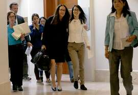 Ellen Pao, center right, walks with her attorney Therese Lawless toward a news conference at Civic Center Courthouse in San Francisco, Friday, March 27, 2015. A jury decided Friday that a prestigious venture capital firm did not discriminate or retaliate against Pao in a case that shined a light on gender imbalance and working conditions for women in Silicon Valley. (AP Photo/Jeff Chiu)