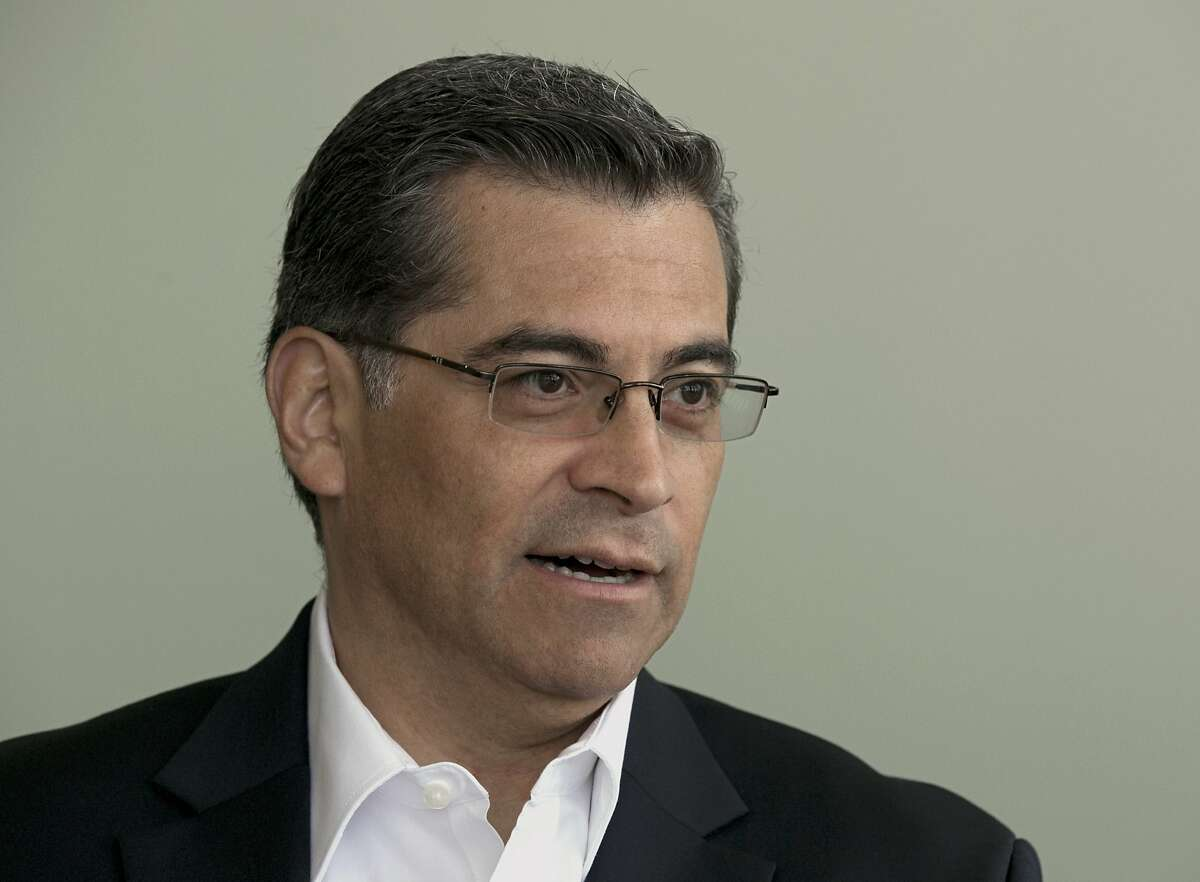 FILE - In this Friday, June 9, 2017 file photo, California Attorney General Xavier Becerra speaks during an interview with The Associated Press, in Sacramento, Calif. A Riverside County judge on Friday, June 16, is expected to hear arguments over whether a lawsuit by doctors challenging the state's 2016 law permitting medically-assisted death can move forward. Becerra says the suit should be dismissed because doctors aren't bound to issue these prescriptions and the law merely offers patients a choice. (AP Photo/Rich Pedroncelli, File)
