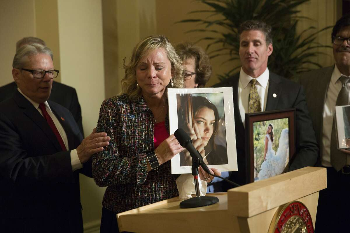 In this Sept. 11, 2015 photo, Debbie Ziegler, the mother of Brittany Maynard, speaks to the media in Sacramento after the passage of legislation which would allow terminally ill patients to legally end their lives. The right-to-die law will apparently remain suspended for at least another month after a judge reaffirmed his ruling that the law was illegally considered and passed during a special legislative session on health care.