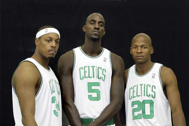 Boston Celtics teammates (from left) Paul Pierce, Kevin Garnett and Ray Allen pose during team media day in Waltham, Mass., on Sept. 29, 2008.