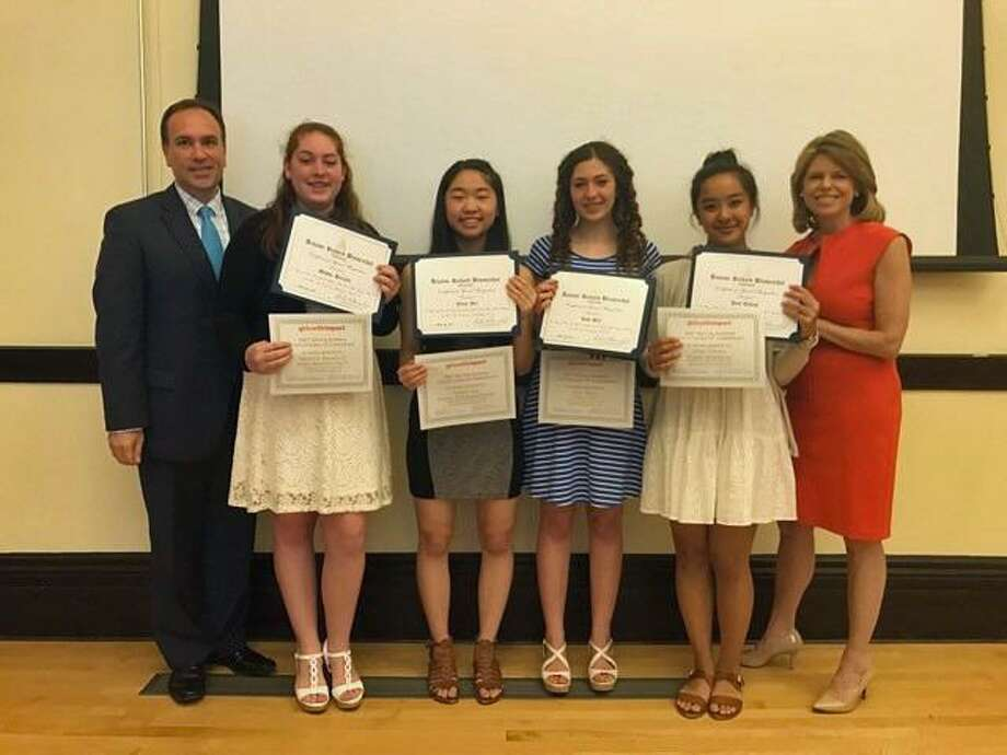 Greenwich First Selectman Peter Tesei, left, stands with Girls With Impact participants Maddie Bassalik, Jamie Yee and Jody Bell of Greenwich, Jess Takami of Fairfield and Girls With Impact Founder Jennifer Openshaw at a luncheon Monday. Photo: Contributed Photo