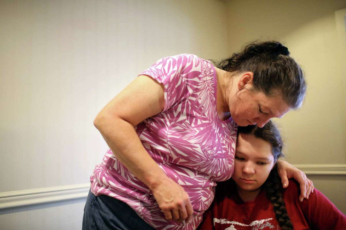 Pamela hugs her daughter Jillian, 12, as she homeschools her in the Mary's Place day center on 7th Avenue, June 26, 2017. Pamela moved with her daughter to Seattle from their home in Kentucky two months ago to be closer to her older children and to find better schools and healthcare for her Jillian.